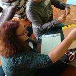 Photo of women at handbound bookmaking workshop